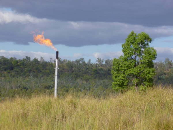 Coal seam gas being flared from a production site in rural Queensland